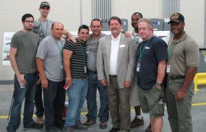 Mayor Joe McCourry visited with Nebraska Furniture Mart employees during a press event at the site in October.